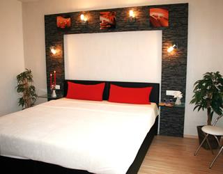 Ferienwohnung Villa Waldblick – Schlafzimmer FeWo 1